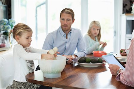 Father and daughters preparing food in kitchen Stock Photo - Premium Royalty-Free, Code: 698-07587843