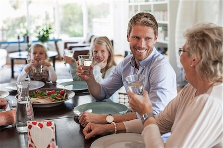 Happy family having lunch together at home Stock Photo - Premium Royalty-Free, Code: 698-07587854