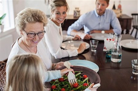 Multi-generation family having lunch at dining table Stock Photo - Premium Royalty-Free, Code: 698-07587851