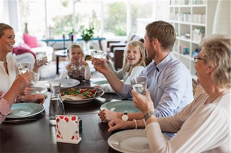 Multi-generation family having lunch together Stock Photo - Premium Royalty-Free, Code: 698-07587853