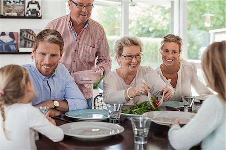 Multi-generation family having lunch together at home Stock Photo - Premium Royalty-Free, Code: 698-07587864
