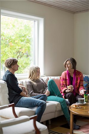 Three generation females spending leisure time in living room Stock Photo - Premium Royalty-Free, Code: 698-07587887