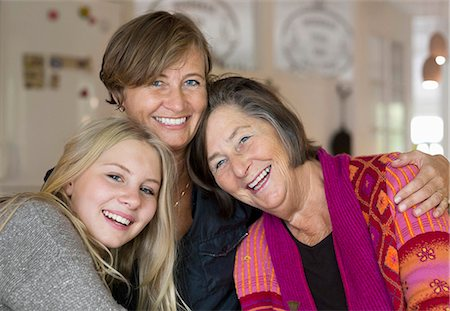 Portrait of happy three generation females at home Stock Photo - Premium Royalty-Free, Code: 698-07587896