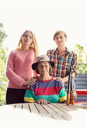 Portrait of three generation females in yard Stock Photo - Premium Royalty-Free, Code: 698-07587914