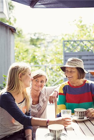 Three generation females having coffee in yard Stock Photo - Premium Royalty-Free, Code: 698-07587916