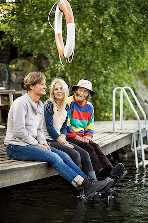 Three generation females sitting on pier Stock Photo - Premium Royalty-Free, Code: 698-07587919