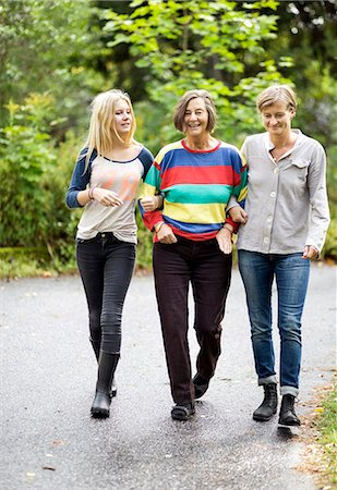 senior lady walking - Three generation females walking on street Stock Photo - Premium Royalty-Free, Code: 698-07587925
