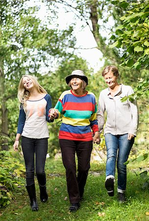 senior lady walking - Happy three generation females walking in park Stock Photo - Premium Royalty-Free, Code: 698-07587922