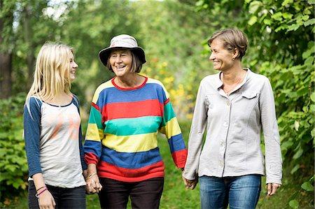 Happy three generation females at park Stock Photo - Premium Royalty-Free, Code: 698-07587923