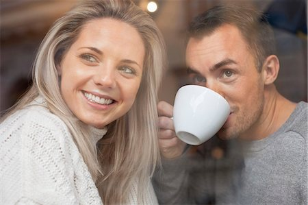 european cafe bar - Happy couple looking out of cafe window Stock Photo - Premium Royalty-Free, Code: 698-07587937