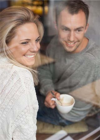 european cafe bar - Happy couple looking out of cafe window while having coffee Stock Photo - Premium Royalty-Free, Code: 698-07587938