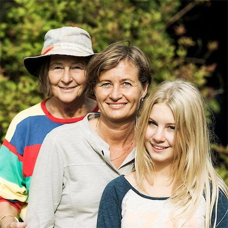Portrait of happy three generation females at yard Stock Photo - Premium Royalty-Free, Code: 698-07587930
