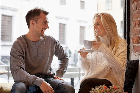 european cafe bar - Happy young couple spending leisure time at cafe Stock Photo - Premium Royalty-Free, Code: 698-07587932