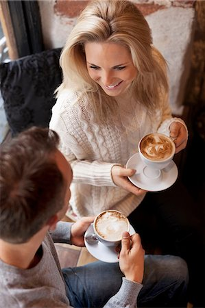 High angle view of young couple having coffee at cafe Stock Photo - Premium Royalty-Free, Code: 698-07587933