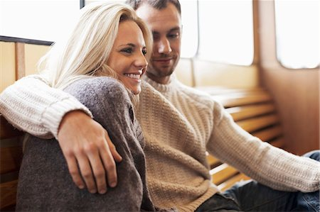 Romantic young couple sitting on ferry Stock Photo - Premium Royalty-Free, Code: 698-07587946
