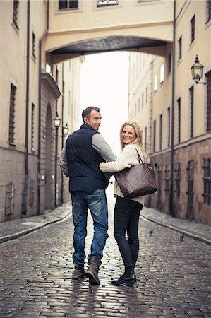 Full length of happy couple walking on city street Stock Photo - Premium Royalty-Free, Code: 698-07587941