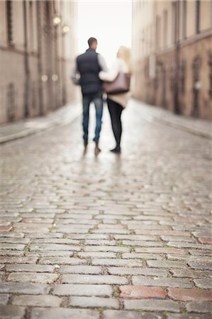 Surface level of street with couple in background Stock Photo - Premium Royalty-Free, Code: 698-07587942