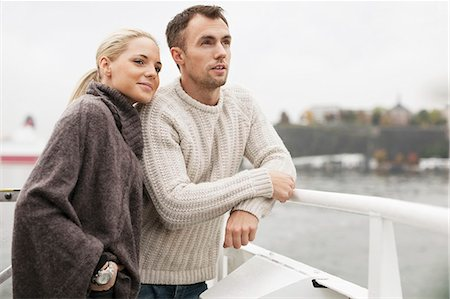 Young couple leaning on railing outdoors Stock Photo - Premium Royalty-Free, Code: 698-07587950