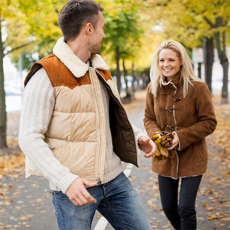 Playful young couple on street during autumn Stock Photo - Premium Royalty-Free, Code: 698-07587968