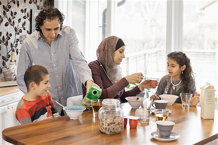 Family having breakfast together at home Stock Photo - Premium Royalty-Free, Code: 698-07587983