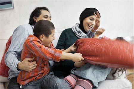 Playful Muslim family in living room Stock Photo - Premium Royalty-Free, Code: 698-07588008