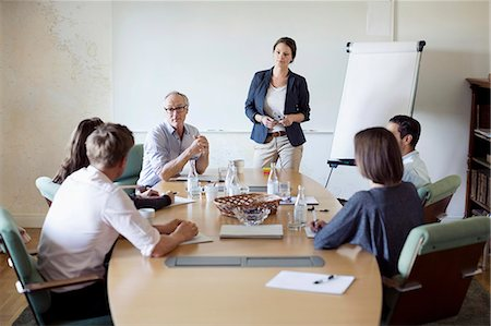 focus on background - Group of business people in conference meeting Stock Photo - Premium Royalty-Free, Code: 698-07588037
