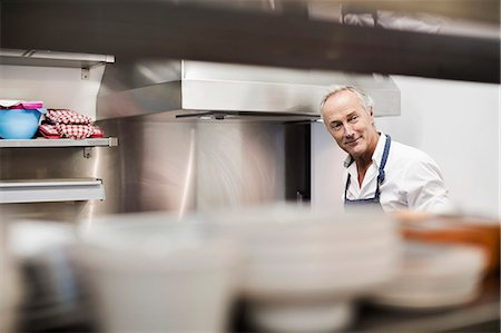 Senior chef in commercial kitchen Stock Photo - Premium Royalty-Free, Code: 698-07588058