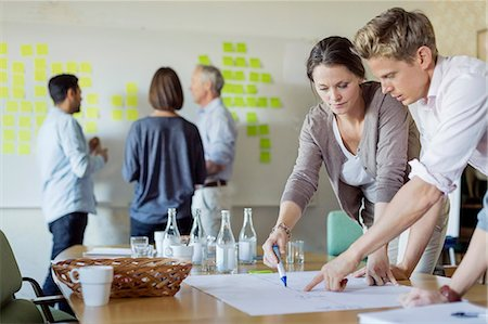 self adhesive note - Business people discussing over blueprint at conference table Stock Photo - Premium Royalty-Free, Code: 698-07588051