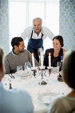 Senior chef talking to business people at dining table in restaurant Stock Photo - Premium Royalty-Free, Code: 698-07588063