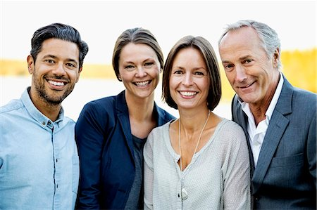 person - Portrait of happy business people outdoors Stock Photo - Premium Royalty-Free, Code: 698-07588089
