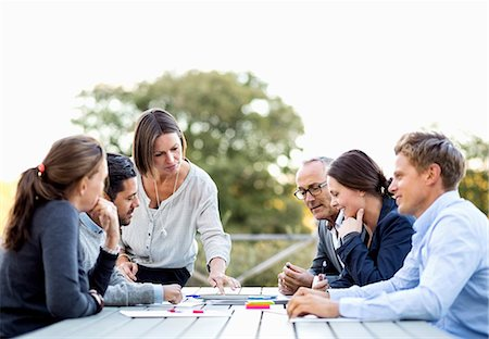 Group of business people working on patio Stock Photo - Premium Royalty-Free, Code: 698-07588083