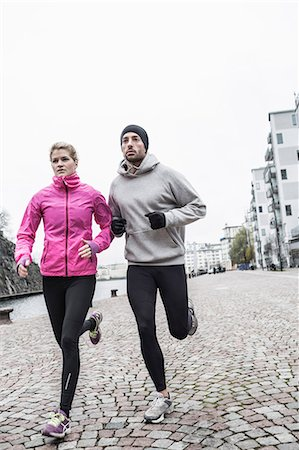 physical fitness - Sporty couple running on street Stock Photo - Premium Royalty-Free, Code: 698-07588101