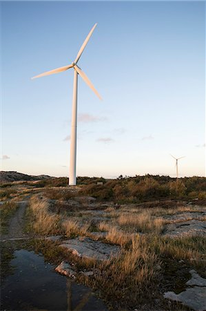 Wind turbines against blue sky Photographie de stock - Premium Libres de Droits, Code: 698-07588125