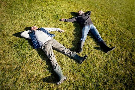 High angle view of mature couple lying on grass Stock Photo - Premium Royalty-Free, Code: 698-07588179