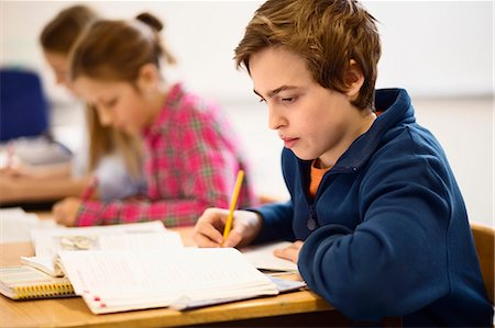 High school students studying at desk in classroom Stock Photo - Premium Royalty-Free, Code: 698-07588239