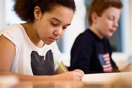 High school girl studying in class Stock Photo - Premium Royalty-Free, Code: 698-07588240