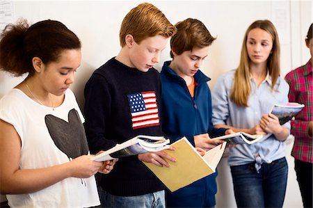friendship - Students studying while standing in classroom Stock Photo - Premium Royalty-Free, Code: 698-07588251