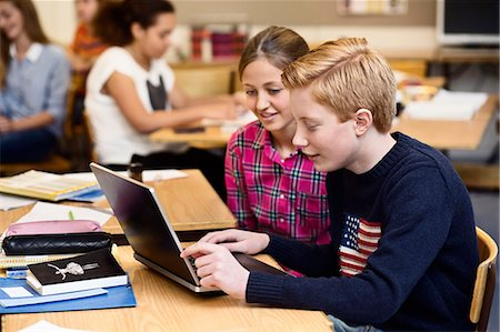 school desk - School students using laptop in classroom Stock Photo - Premium Royalty-Free, Code: 698-07588265