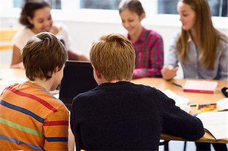 High school students using laptop in classroom Stock Photo - Premium Royalty-Free, Code: 698-07588262