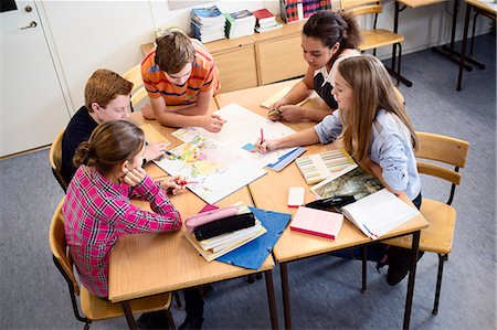 studying (all students) - High angle view of students discussing over map in classroom Stock Photo - Premium Royalty-Free, Code: 698-07588276