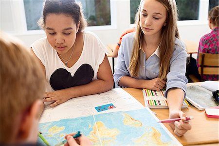 High school students studying map at desk Stock Photo - Premium Royalty-Free, Code: 698-07588277
