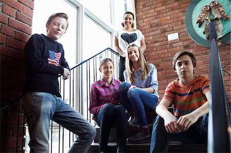 Portrait of confident friends on high school steps Stock Photo - Premium Royalty-Free, Code: 698-07588299