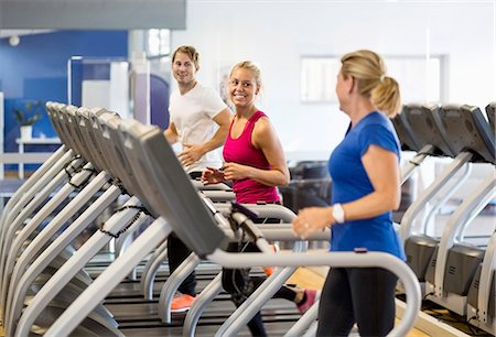Friends exercising on treadmills at health club Stock Photo - Premium Royalty-Free, Code: 698-07588314