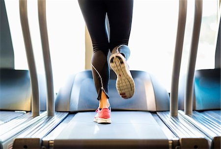 equipment - Low section of woman exercising on treadmill Stock Photo - Premium Royalty-Free, Code: 698-07588315