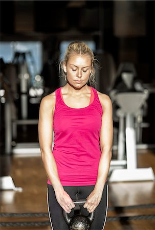sports - Young woman exercising with kettlebell in health club Stock Photo - Premium Royalty-Free, Code: 698-07588311