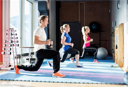 People exercising with kettlebells at gym Stock Photo - Premium Royalty-Free, Code: 698-07588324