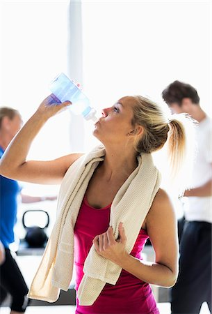 Fit young woman drinking water at health club Stock Photo - Premium Royalty-Free, Code: 698-07588320