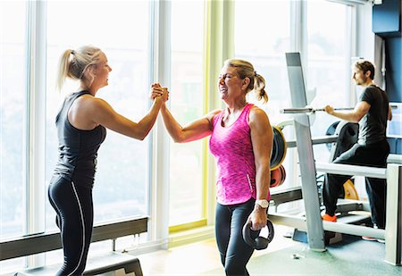 Happy women at health club Stock Photo - Premium Royalty-Free, Code: 698-07588340
