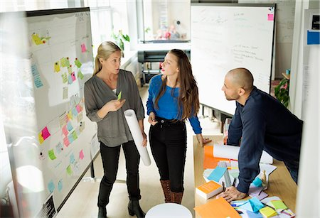 Business people discussing in creative office Stock Photo - Premium Royalty-Free, Code: 698-07588429