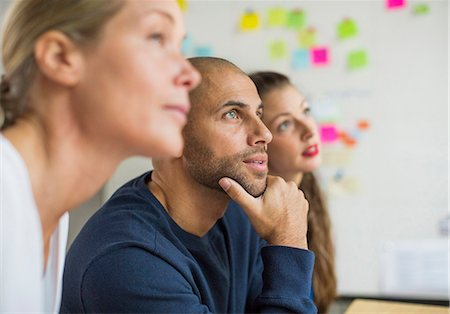 Business people looking away in creative office Stock Photo - Premium Royalty-Free, Code: 698-07588422